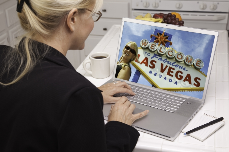 543543-woman-in-kitchen-using-laptop-las-vegas