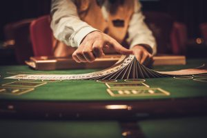 Croupier,Behind,Gambling,Table,In,A,Casino.